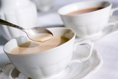 Teaspoon over cup of tea or co Stock Photography