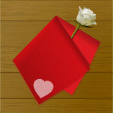 Teat towel folded on a rose on wood background Royalty Free Stock Photo