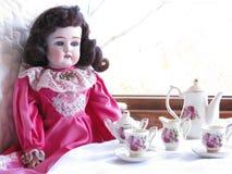 teatid för docka s Royaltyfri Bild