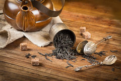 Teatime with black tea Stock Images