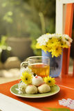Teatime with Chinese pastry and tea and flower on a orange chair. Afternoon teatime with Chinese pastry and tea and flower on a orange chair in garden stock photos