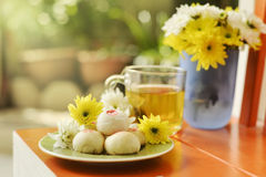 Teatime with Chinese pastry and tea and flower on a orange chair Royalty Free Stock Photo