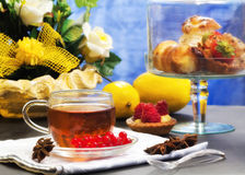Teatime with fancy cakes and spices Stock Image