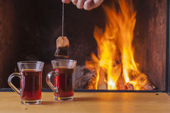 Teatime at the fireplace Royalty Free Stock Images