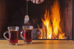 Teatime at the fireplace Stock Photos