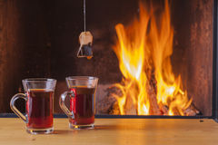 Teatime at the fireplace Royalty Free Stock Photo