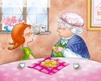 Teatime: Oma met haar grandaughter stock afbeelding