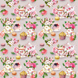 Teatime pattern: flowers, teacup, cake, teapot. Watercolor. Seamless background. Tea pattern with flowers cherry blossom, rose flower in tea cup, cakes stock photo