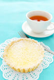 Teatime snack. Appetising dessert of lemon tart and a cup of tea royalty free stock photo