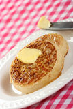 Teatime treat of buttered crumpets Stock Image