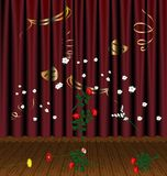 Teatrical scene and flowers. Against the backdrop of sinking theater curtain on the stage fall flowers Stock Image