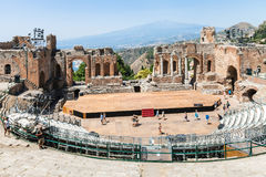 Teatro antico and view of Etna mount in Taormina Stock Images
