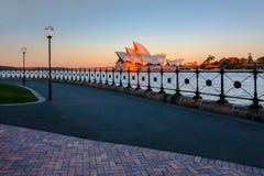 Teatro de la ópera de Sydney en la puesta del sol Fotos de archivo