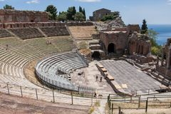 Teatro di Taormina, Sicily, Italy. Ruins of the greek roman theater of Taormina, Sicily, Italy on a hot summer day Royalty Free Stock Photo