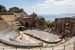 Teatro di Taormina, Sicily, Italy. Ruins of the greek roman theater of Taormina, Sicily, Italy on a hot summer day Stock Image