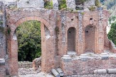 Teatro di Taormina, Sicily, Italy. Ruins of the greek roman theater of Taormina, Sicily, Italy on a hot summer day Royalty Free Stock Image