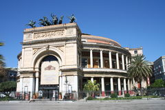 Teatro Massimo Palermo. The imposing facade of Teatro Massimo theatre in downtown Palermo, Sicily with its columns and palm trees Royalty Free Stock Images