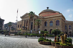 Teatro Massimo Palermo. The imposing facade of Teatro Massimo theatre in downtown Palermo, Sicily with its columns and palm trees Royalty Free Stock Photos
