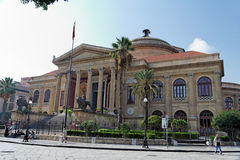 Teatro Massimo Palermo Sicily. The impong facade of Teatro Massimo theatre in downtown Palermo, Sicily with its columns and palm trees Royalty Free Stock Images