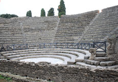 Teatro Piccolo in ancient Pompeii, Italy. The city of Pompeii was an ancient Roman town-city near modern Naples. Pompeii along with Herculaneum and many villas Stock Images