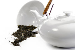 Teaware white in white and some loose tea. Teaware white in white like clinical, and some loose tea, nearly monochrome, cool, clean, medical style Stock Image