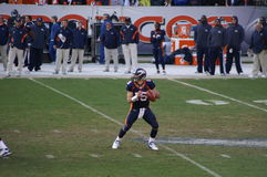 Tebow. Denver bronco's quarteback Tim Tebow drops back to pass against chiefs. Tebow and the broncos are playing in the nfl playoffs royalty free stock images
