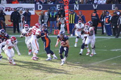 Tebow runs. Denver bronco's quarteback Tim Tebow puts the ball under his arm and runs against chiefs. Tebow and the broncos are playing in the nfl playoffs stock photography