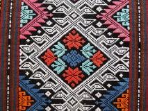 Tecelagem tradicional do norte de Teenjok dos sarongues em Tailândia Fotos de Stock Royalty Free