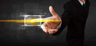 Tech business person touching button with orange light beams con royalty free stock photography