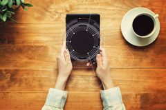 Tech circle with a person holding a tablet. Computer royalty free stock photo