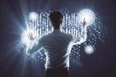 Tech concept. Back view of young businessman pressing creative digital buttons. Tech concept Stock Photos