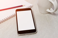 Tech device mock up on office background Stock Image