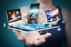 Tech devices connected to each other by businesswoman 3D renderi. Tech devices connected to each other by businesswoman on blurred background 3D rendering Royalty Free Stock Photography