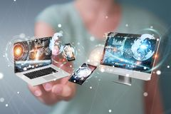 Tech devices connected to each other by businesswoman 3D renderi. Tech devices connected to each other by businesswoman on blurred background 3D rendering Royalty Free Stock Photo