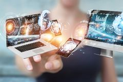 Tech devices connected to each other by businesswoman 3D renderi. Tech devices connected to each other by businesswoman on blurred background 3D rendering Royalty Free Stock Image