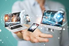 Tech devices connected to each other by businesswoman 3D renderi. Tech devices connected to each other by businesswoman on blurred background 3D rendering Royalty Free Stock Images