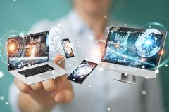 Tech devices connected to each other by businesswoman 3D renderi. Tech devices connected to each other by businesswoman on blurred background 3D rendering Stock Photo