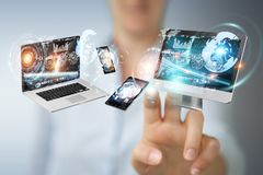 Tech devices connected to each other by businesswoman 3D renderi. Tech devices connected to each other by businesswoman on blurred background 3D rendering Stock Image