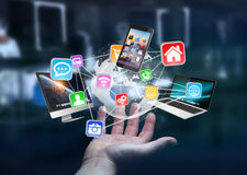 Tech devices and icons connected to digital planet earth Stock Photos