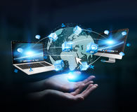 Tech devices and icons connected to digital planet earth Royalty Free Stock Photo