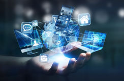 Tech devices and icons connected to digital planet earth. Businesswoman connected tech devices and icons applications to a digital planet earth Stock Photos