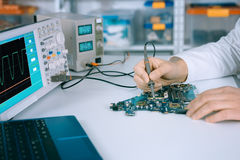Tech fixes motherboard in service center Stock Image