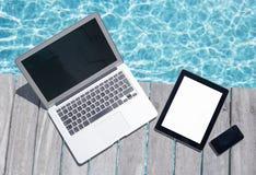 Tech gadgets on wooden deck Stock Photos