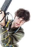 Tech rage. A casual guy with tangled cables and a keyboard struggeling to get computer assistance. isolated on white Stock Photos