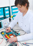 Tech repairs electronic equipment Royalty Free Stock Photo