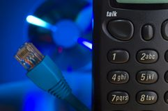 Tech Support. Telephone keypad with blue IT themed background (CD/DVD and cat5 cable Royalty Free Stock Photography