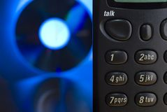 Tech Support. Telephone keypad with blue IT themed background (CD/DVD Stock Photography