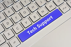 Tech Support. Clean Gray Laptop Keyboard With Blue Spacebar Writing Tech Support royalty free stock photo