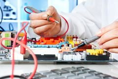 Tech tests electronic equipment Stock Photos