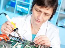 Tech tests electronic equipment Royalty Free Stock Image